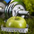 Apple with measuring of dumbbell — Stockfoto