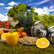 Foto Stock: Fitness Food and green grass with blue sky