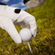 Hand and golf ball - Foto Stock