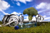 Dumbell and green grass — Stock Photo