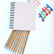 Notepad with school supplies — Stock Photo