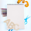 Notepad with school supplies — Foto Stock