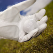Hand and golf ball - Stockfoto