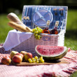 Picnic basket with fruit bread and wine — Stock Photo #13143148
