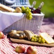 Постер, плакат: Picnic basket with fruit bread and wine