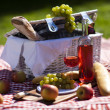 Picnic basket with fruit bread and wine — Stock Photo #13147023