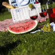 Picnic basket with fruit bread and wine — Stock Photo #13147056