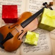 Gift and violin — Stock Photo #14435171