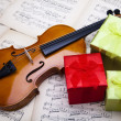 Gift and violin — Stock Photo #14435299