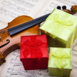 Gift and violin — Stock Photo #14436469