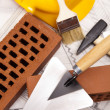 Hard hat with bricks and trowel - Stockfoto