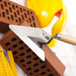 Brick, yellow hard hat, tools - Foto de Stock