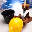 Brick, yellow hard hat, tools — Stock Photo