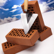 Building background, trowel and bricks - Stockfoto