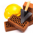 Hard hat with bricks and trowel - ストック写真
