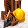 Building background, trowel and bricks - Foto Stock