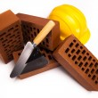 Brick, yellow hard hat, tools - 