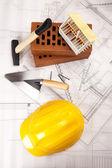 Brick, yellow hard hat, tools — Stock Photo