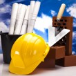 Construction plans and blueprints, bricks — Stock Photo