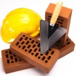 Building background, trowel and bricks — Stockfoto