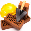 Building background, trowel and bricks — Stock Photo