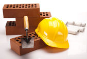 Brick, trowel tool and Construction plans — Stock Photo