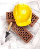 Building house, trowel and bricks — Stock Photo