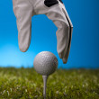 Hand and golf ball — Stock Photo