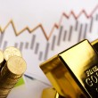 Gold bars and coins — Stock Photo #18861157