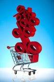 Shopping cart with sign of percentage, sale — Stock Photo