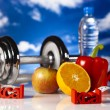 Diet and fitness, dumbell in vitamins — Stock Photo #24800489