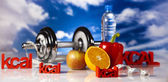 Diet and fitness, dumbell in vitamins — Stock Photo