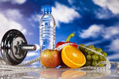 Dumbell and vitamins, blue sky — Stock Photo