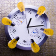 Clock with lightbulbs — Stock Photo