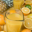 Orange juice and fresh fruits — ストック写真