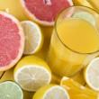 Orange juice and citrus fruit — Stock Photo