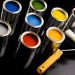 Cans of paint and roller — Stock Photo