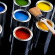 Paint brush and cans of paint — Stock Photo