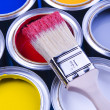 Paint brush and cans of paint — Lizenzfreies Foto