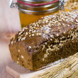 A loaf of bread and honey — Stock Photo