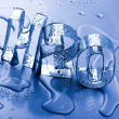 Stock Photo: H2O letters and waterdrops