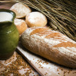 Jug of milk and a loaf of bread — Stock Photo