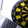 Laptop & Darts — Stock Photo