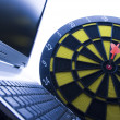 Laptop & Darts — Stock Photo #30692643