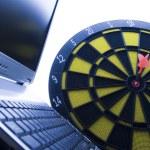 Laptop & Darts — Stock Photo
