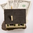Dollars & House for sale — Stock Photo
