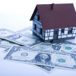 Stock Photo: Dollars & House for sale