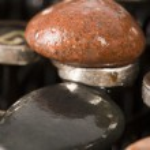 Typewriter with stones — Stock Photo