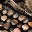 Typewriter with stones — Stock Photo