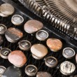 Typewriter with stones — Stock Photo #30698221